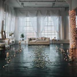 Beautiful wedding room with drapes, couch and floral aisle